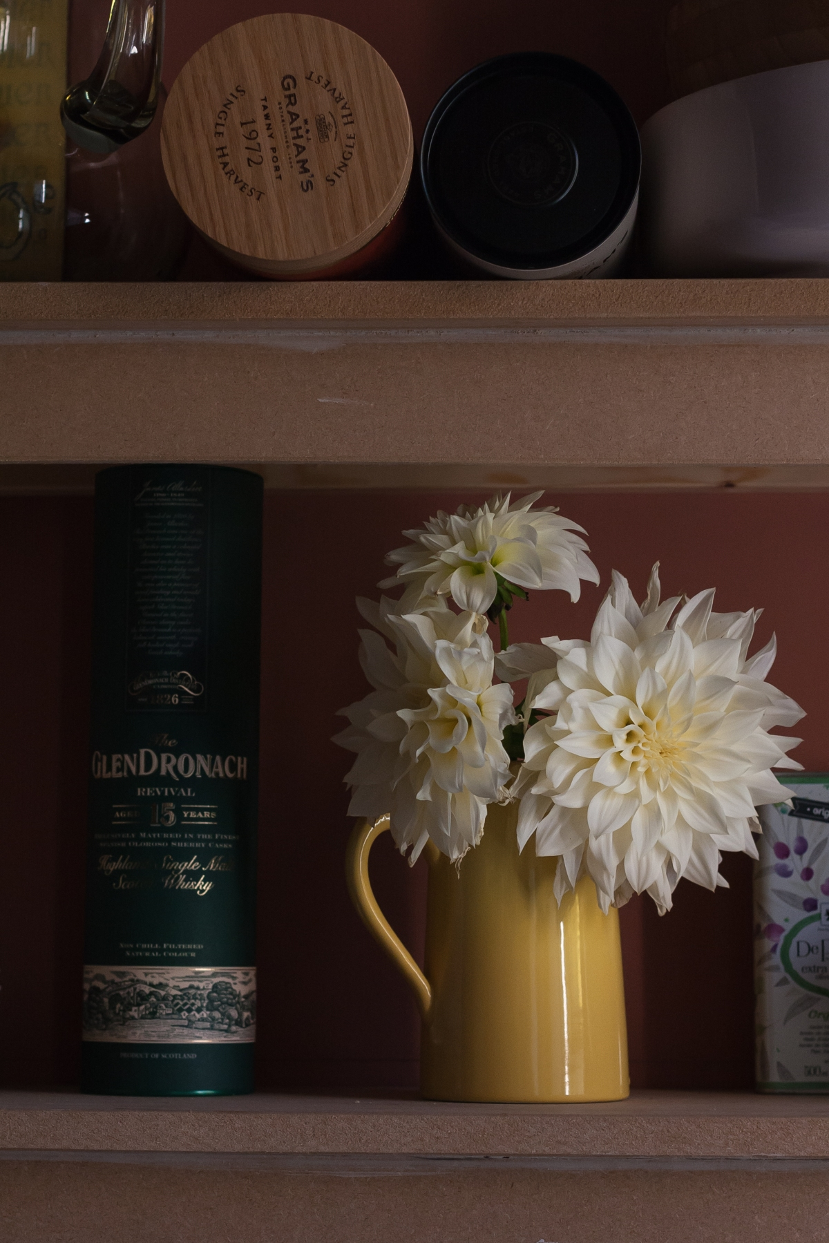 In a vase on Monday: Fading dahlias on an unpaintedshelf